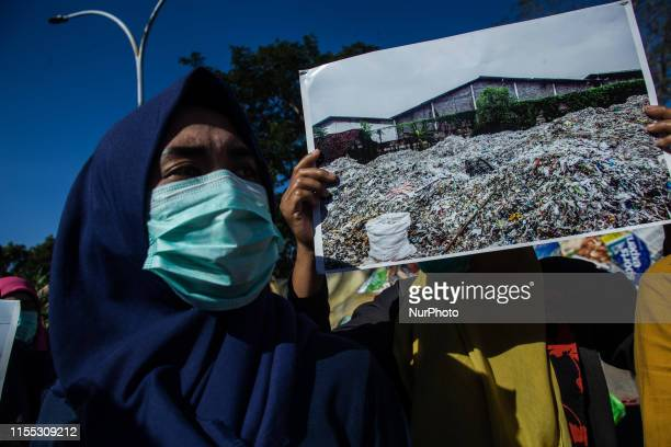 Indonesian activist bring placard and banners during the demonstration to reject imported waste not far from the US consulate general office in...