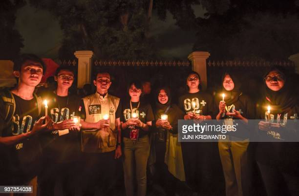 TOPSHOT Indonesian activists light up candles during the Earth Hour in Yogyakarta in Java island on March 24 2018
