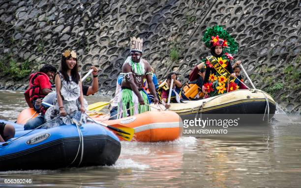 Indonesian activists parade in various costumes along the Kalimas river in Surabaya on March 22 2017 to help draw attention to World Water Day...