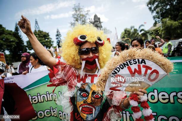 Indonesian activists wears anti WTO costum during a protest against the World Trade Organization meeting on December 3 2013 in Denpasar Indonesia...