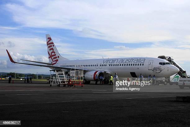 Indonesian Air Force army guard Boeing 737-800 of Virgin Australia at Ngurah Rai International Airport in Kuta, Bali on Friday, April 25, 2014. An...