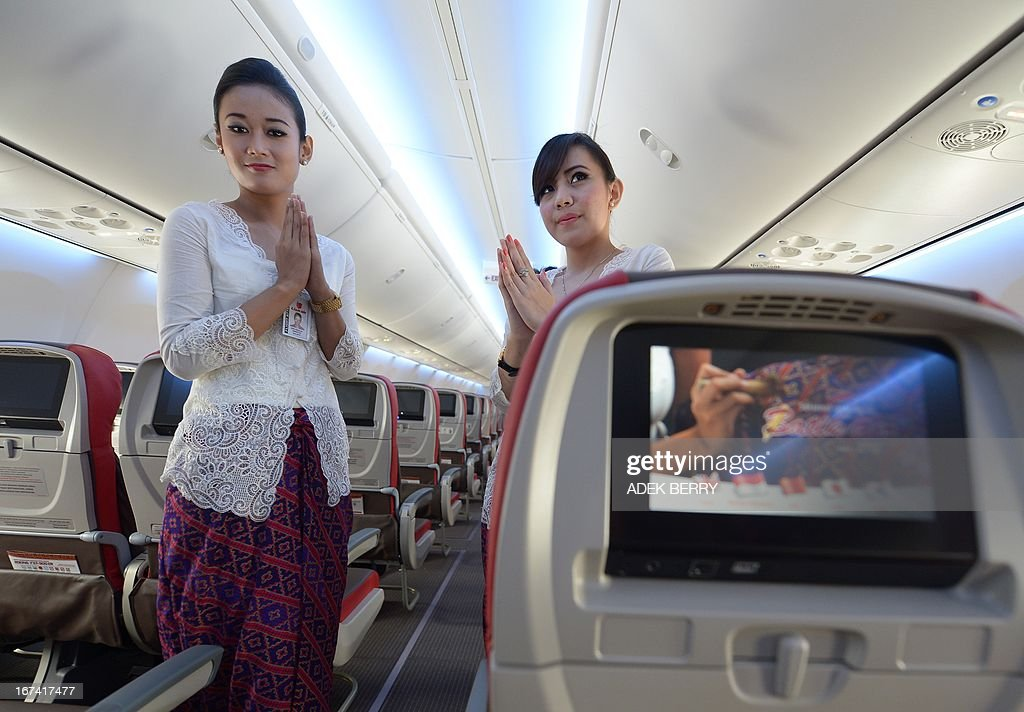 Indonesian air hostess pose inside a Boeing 737-900 plane of the new Indonesian airline Batik Air, a subsidiary of Lion Air is parked at the Soekarno-Hatta airport during the launching ceremony in ...