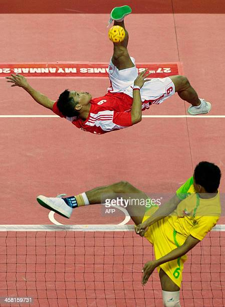 Indonesian and Myanmar players compete in the double team sepak takraw event during the 27th Southeast Asian SEA Games in Naypyidaw on December 20...