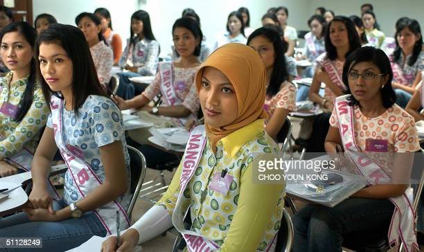 Indonesian Andina from the troubled Aceh province studies how to make good makeup during a beauty contest of young women vying to be the next Miss...