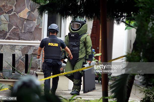 Indonesian antibomb squad carry an explosive from the Santo Yosef chuch after a man tried to attack a priest in Medan on August 28 2016 A...