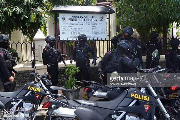 Indonesian antiriot police secure a church in Malang East Java province on December 24 2016 Indonesian police on December 22 announced plans to...