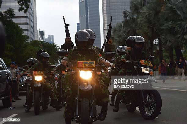 TOPSHOT Indonesian armed military patrol the area near cafe after a series of blasts hit Jakarta on January 14 2016 An attack on Jakarta is over and...