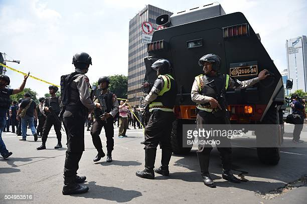 Indonesian armed police clear the area near a Starbucks after a series of blasts hit Jakarta on January 14 2016 An attack on Jakarta is over and no...