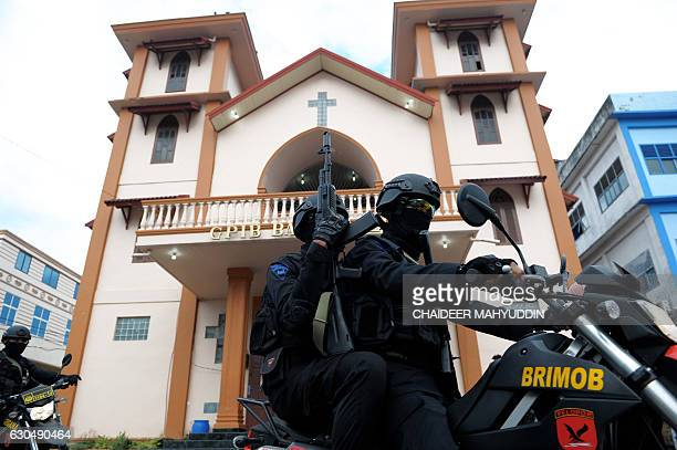 Indonesian armed police secure a church in Banda Aceh Aceh province on December 24 ahead of Christmas Mass Indonesian police on December 22 announced...