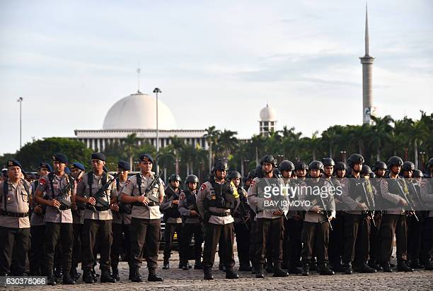 Indonesian armed police take part in a roll call in Jakarta on December 22 as part of efforts to secure Christmas and New Year celebrations...