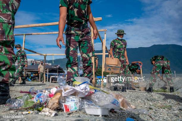 Indonesian Army soldiers collect plastic waste scattered in the Talise Beach area, Palu, Central Sulawesi Province, Indonesia on July 23, 2021. The...