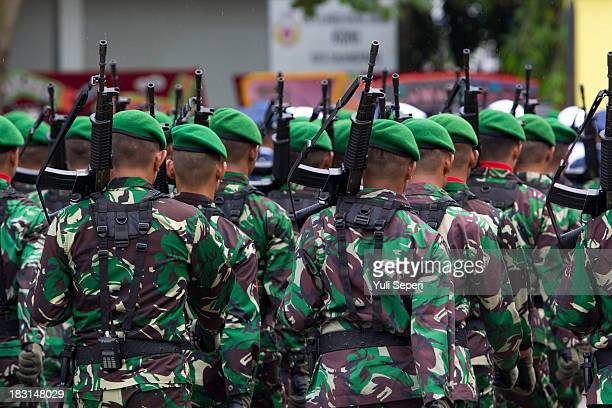 Indonesian Army soldiers march during the 68th anniversary commemoration of the Indonesian Military or TNI on October 5, 2013 in Bintan Island,...