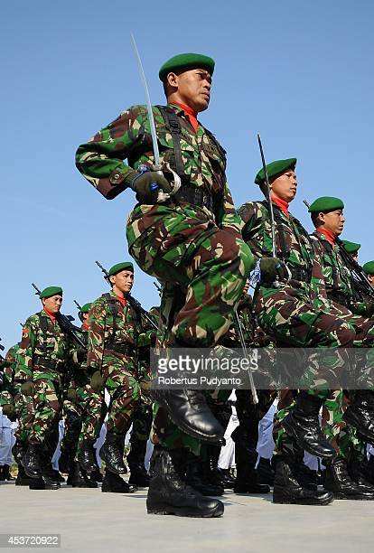 Indonesian Army soldiers parade during the Indonesian 69th Independence Day Anniversary ceremony at the Surabaya City Hall on August 17 2014 in...