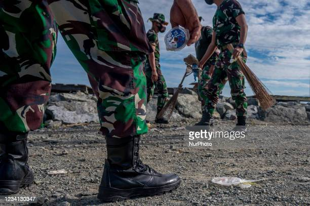 Indonesian Army soldiers pick up plastic waste scattered in the Talise Beach area, Palu, Central Sulawesi Province, Indonesia on July 23, 2021. The...