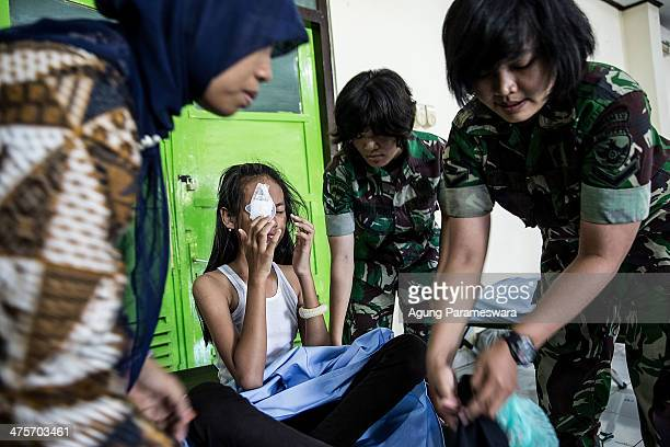 Indonesian army women help a patient who underwent cataract surgery at Udayana Army Hospital March 1 2014 in Denpasar Bali Indonesia More than 400...