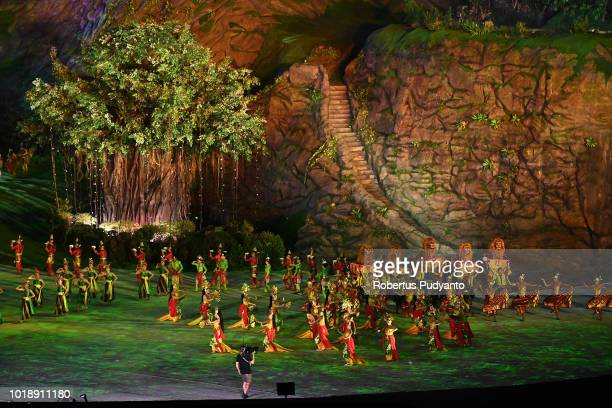 Indonesian artists perform during the opening ceremony of the Asian Games 2018 at Gelora Bung Karno Stadium on August 18 2018 in Jakarta Indonesia