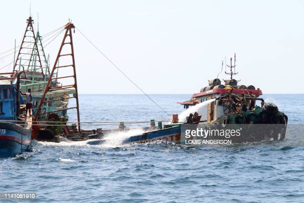 Indonesian authorities sink a Vietnamese fishing boat at Datuk island in West Kalimantan on May 4 2019 Indonesia began to sink impounded foreign...