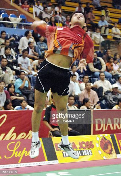 Indonesian badmintion player Simon Santoso leaps in the air to send a smash to his South Korean opponent HO Cheol Lee during the Indonesian Open 2005...