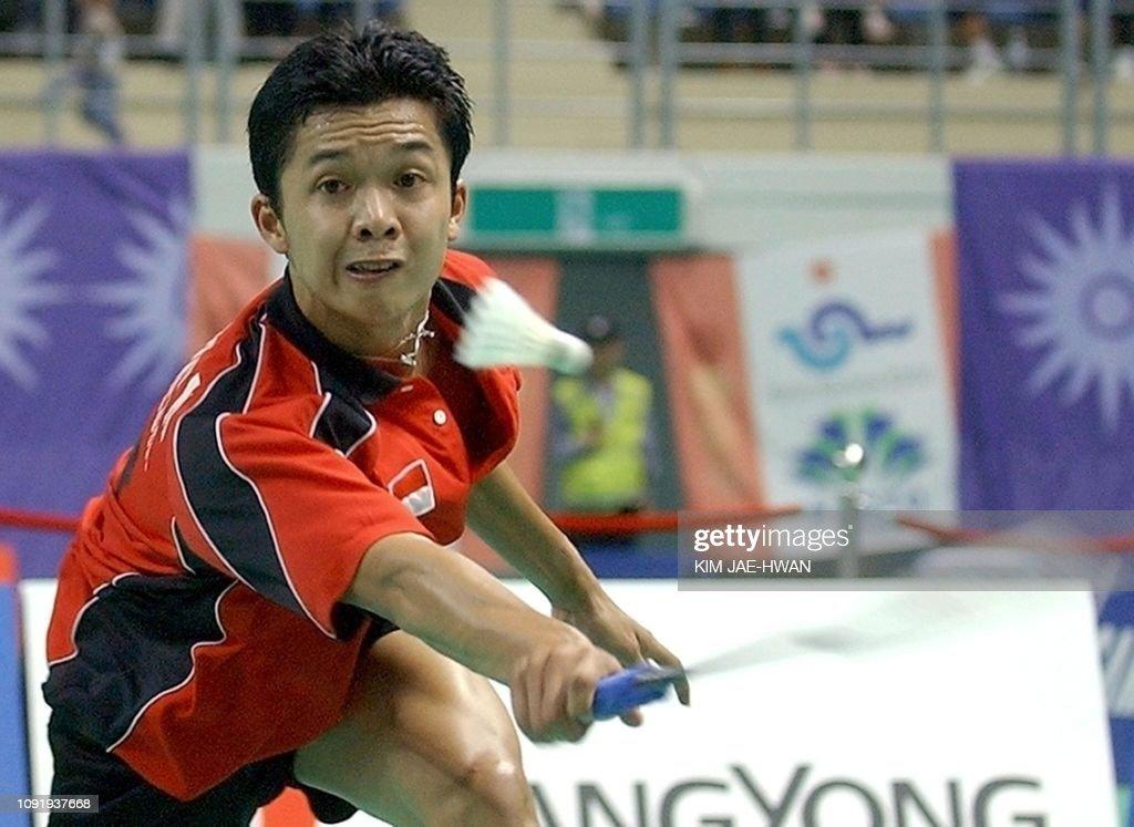 Indonesian badminton player Taufik Hidayat hits a return ...