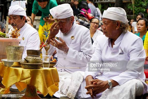 Indonesian Balinese people pray during a parade on the evening of the Day of Silence locally known as 'Nyepi' that mark Balinese Hindu New Year in...