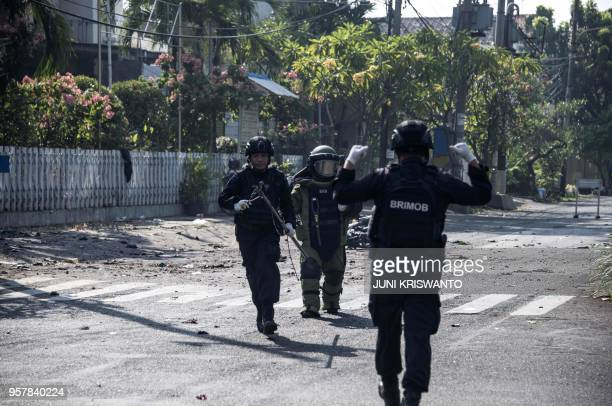 Indonesian bomb squade examine the site following a suicide bomb outside a church in Surabaya on May 13 2018 At least two people were killed and 13...