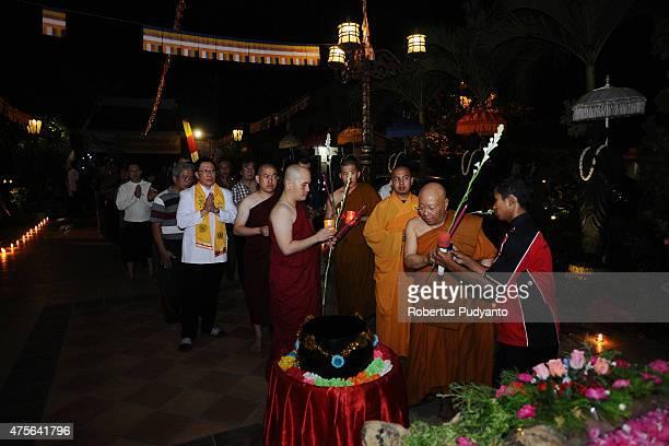 Indonesian Buddhists Monks lead the Vesak Day 2559 BE ceremony at Maha Vihara Mojopahit Trowulan on June 2 2015 in Mojokerto Indonesia Millions of...