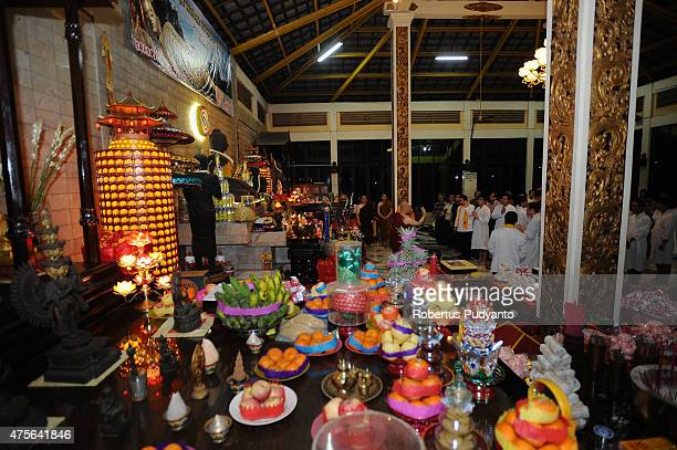 Indonesian Buddhists pray during the Vesak Day 2559 BE ceremony at Maha Vihara Mojopahit Trowulan on June 2 2015 in Mojokerto Indonesia Millions of...