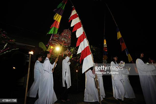 Indonesian Buddhists walk around Maha Vihara Mojopahit Trowulan follow Pradakshina path during the Vesak Day 2559 BE ceremony on June 2 2015 in...