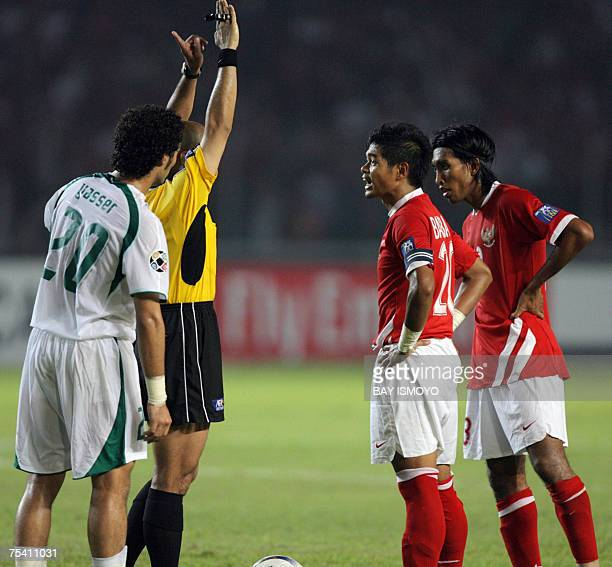 Indonesian captain Bambang Pamungkas protests a call by referee Ali Al Badwawi during the Asian Cup 2007 Group D football match against Indonesia at...