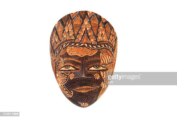 Indonesian carving mask on white background