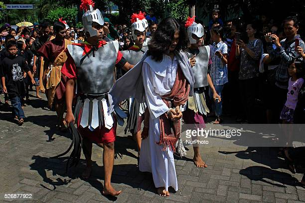 Indonesian Catholicsparticipate in a theatrical act of the Crucifixion of Jesus Christ on Good Friday at Ganjuran Church Yogyakarta Indonesia on...