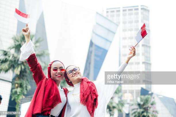 indonesian celebrating independence day - indonesia flag stock photos and pictures