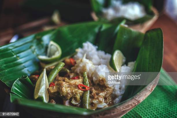 Indonesian Chicken Curry Dish with Rice Served on Banana Leaf