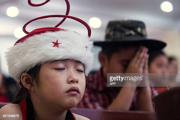 Indonesian children attend a mass prayer at a church in Banda Aceh on December 18 2013 Indonesian Christians will celebrate Christmas amid a warning...
