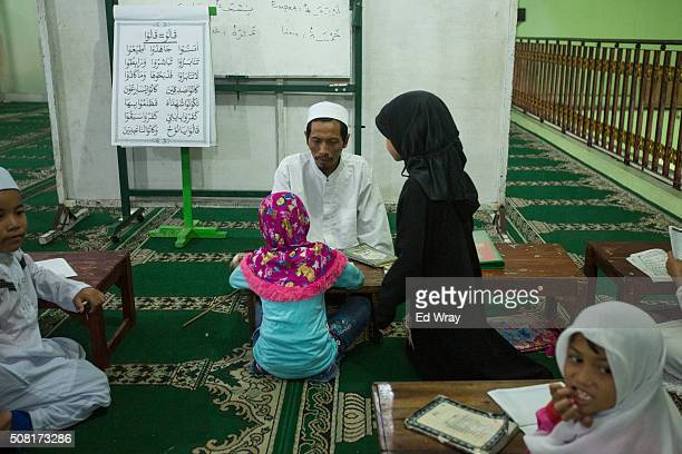 Indonesian children learn Arabic at a mosque on February 1 2016 in Solo Indonesia Solo a medium sized Central Java town is once again the focus of...