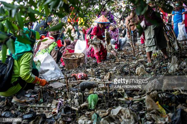 TOPSHOT Indonesian children pick up trash from a beach in Surabaya city East Java province on September 21 as seen during a beach cleanup by children...