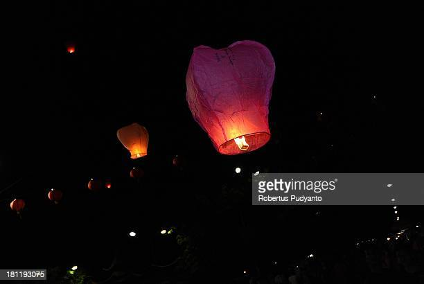 Indonesian Chinese celebrate the Moon Cake festival by releasing Kong Ming paper lanterns at Sanggar Agung Temple on September 19 2013 in Surabaya...