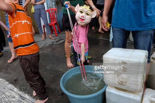 Indonesian Chinese people participate Water War Festival known as Cian Cui Festival at Selatpanjang Meranti Island district in Riau Province...