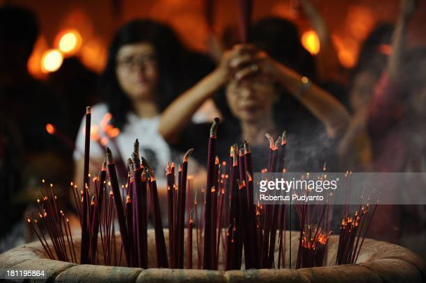 Indonesian Chinese pray to celebrate the Moon Cake festival at Sanggar Agung Temple on September 19 2013 in Surabaya Indonesia The Chinese Tao...