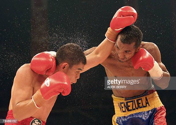Indonesian Chris John and Jose Rojas of Venezuela fight for World Boxing Association featherweight title in Jakarta 03 March 2007 Indonesia's boxing...