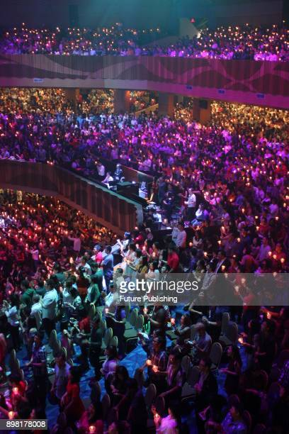 Indonesian Christian congregation light candles to celebrate the Christmas Eve at the Bethany Church on Decembe 24 2017 in Surabaya Indonesia...