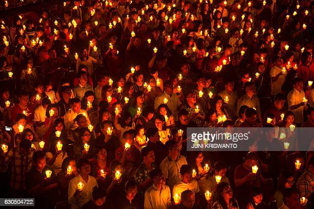 TOPSHOT Indonesian Christians attend a Christmas Eve service at a church in Surabaya East Java province on December 24 2016 Indonesian police on...