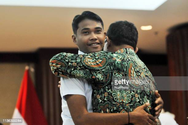 Indonesian citizen who was held hostage by the Abu Sayyaf group in the southern Philippines Heri Ardiansyah hugged his relatives during his surrender...