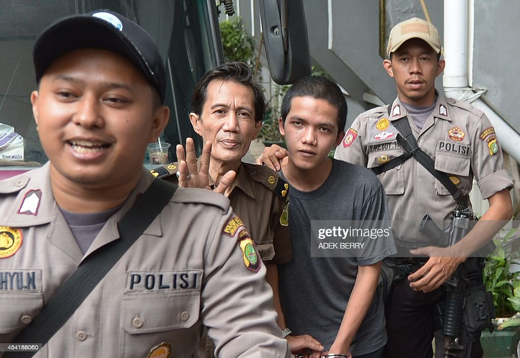 Indonesian cleaner Agun Iskandar (2nd R), one of five cleaners charged over allegations of sexual assault, arrives at the South Jakarta Court in Jakarta on August 26, 2014. Five cleaners were to go on trial this week over allegations of sexual assault at one of Indonesia's most prestigious international schools, the first cases in a long-running scandal to go to court.