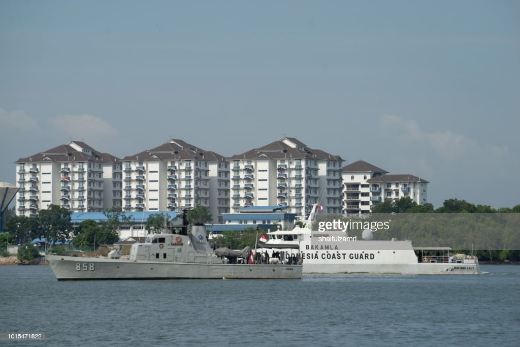 Indonesian coast guard boat perform a routine patrol for any anomaly activities at Port Klang, Malaysia. : Stock Photo