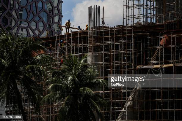 Indonesian construction worker works at a building for office in Jakarta Indonesia on February 11 2019 Indonesia posted slightly stronger economic...