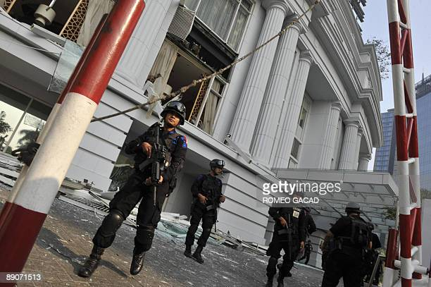 Indonesian counterterrorist police commandos secure the damaged RitzCarlton hotel in Jakarta on July 17 2009 after an explosion hit the RitzCarlton...