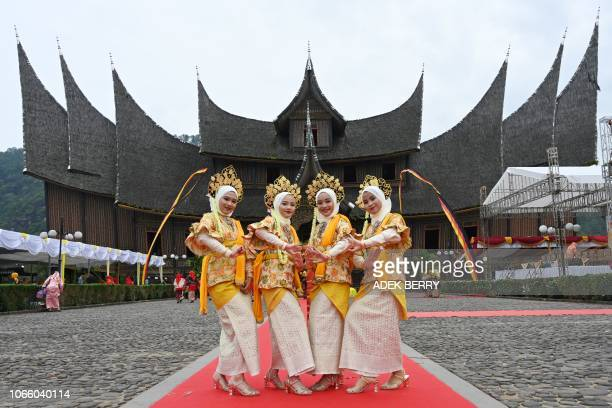 Indonesian dancers in Minangkabau traditional outfits participate at the 2018 Minangkabau art and culture festival in Batusangkar West Sumatra with...