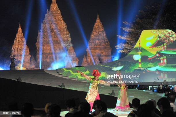 Indonesian dancers perform a Chinese dance during a ceremony at the Prambanan temple in Yogyakarta on July 18 2018 Indonesia will host the 2018 Asian...