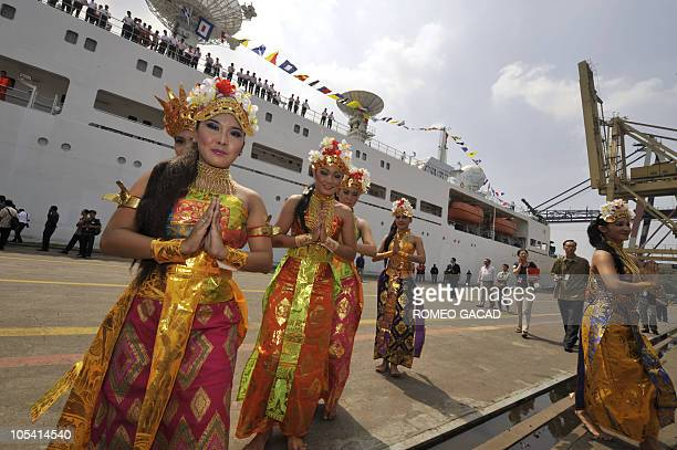 Indonesian dancers perform a traditional dance to welcome the Chinese satellite monitoring ship MV Yuanwang5 on arrival at the Jakarta port on...